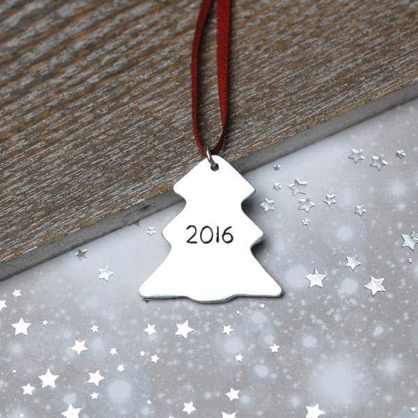Inscription on the back of a personalised silver Christmas decoration