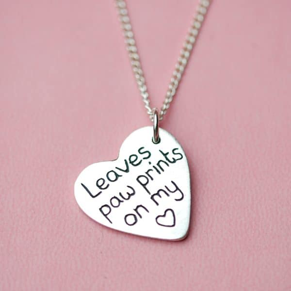 Inscription on the back of a silver heart paw print charm
