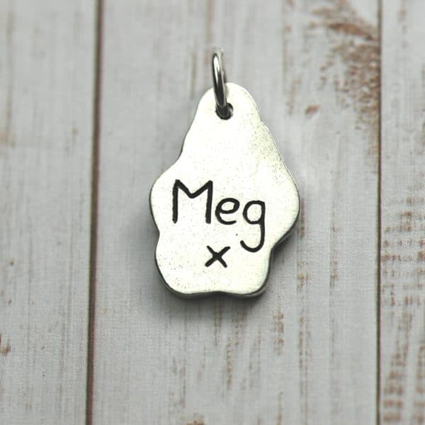 Inscription on the back of small paw print charm