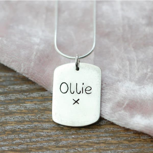 Inscription on the back of large paw print charm