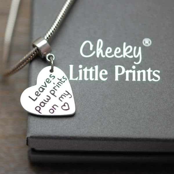 Inscription on the back of paw print charm