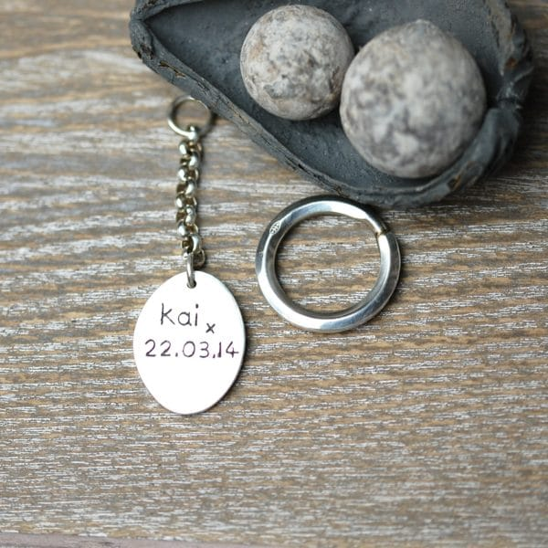 Inscription on the back of a regular silver paw print keyring