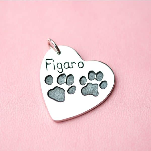 Large silver heart with your pet's unique paw prints and names