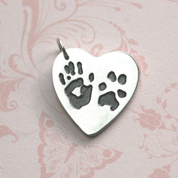 Large silver heart with unique hand and paw prints and names