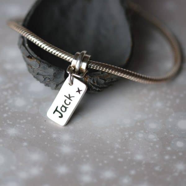 Mini silver personalised name charm with charm carrier