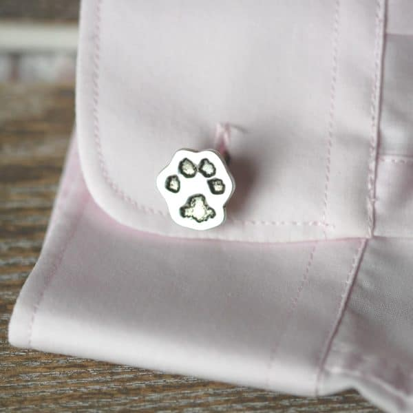 Silver cufflink cut out in the shape of your pet's unique paw print
