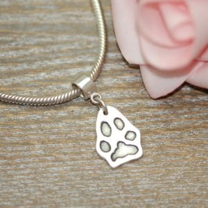 Regular silver paw print charm with charm carrier