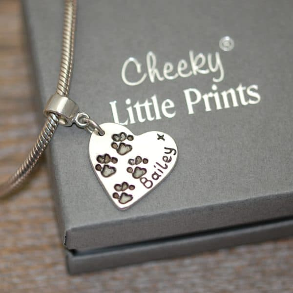 Regular silver heart paw print charm with charm carrier