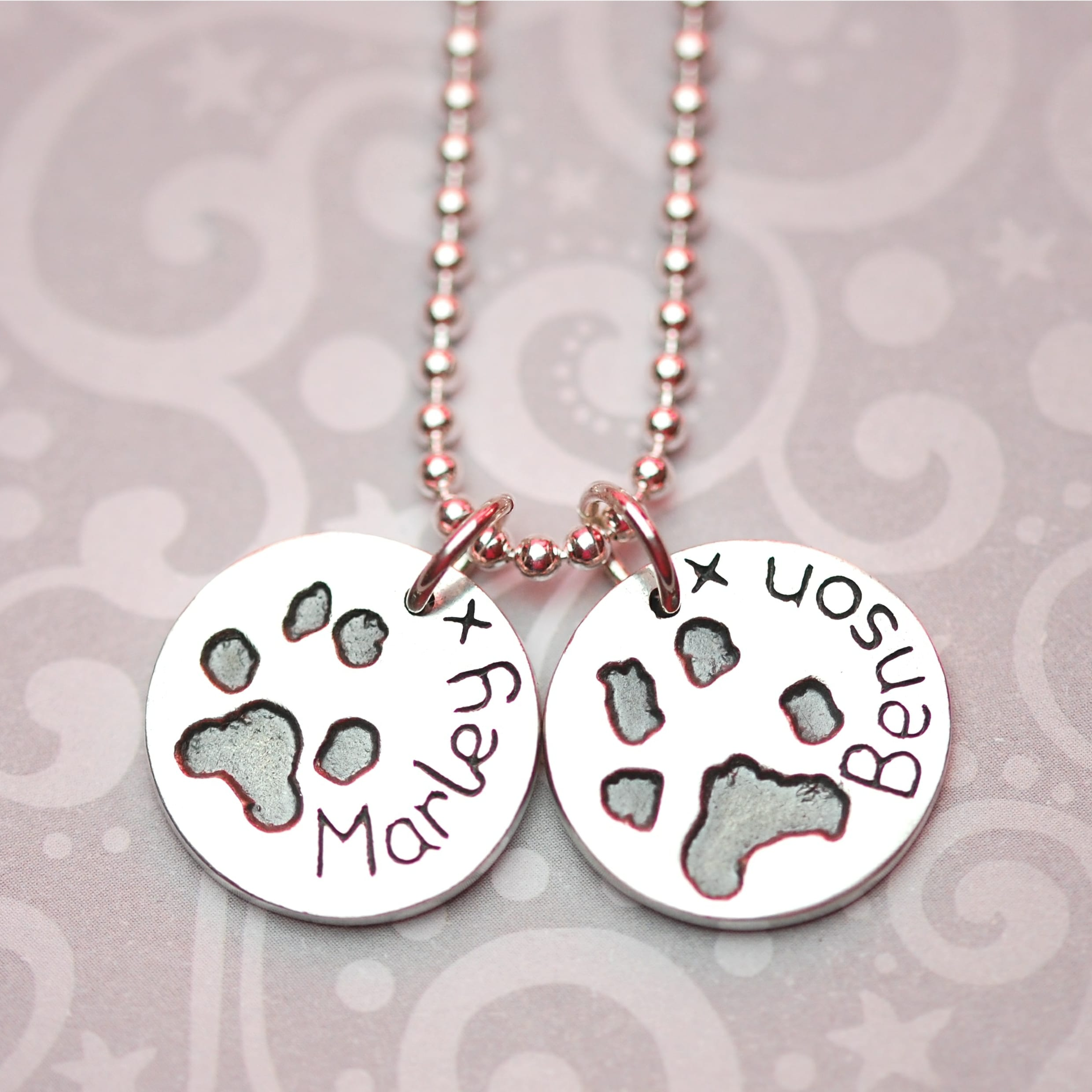 Regular silver circle charms with your dog's paw prints and names