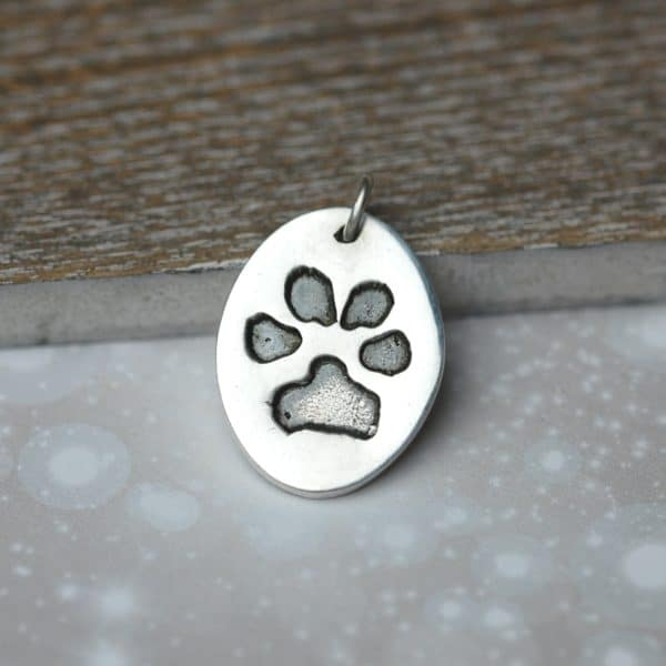 Silver oval charm showcasing your animal's unique paw print
