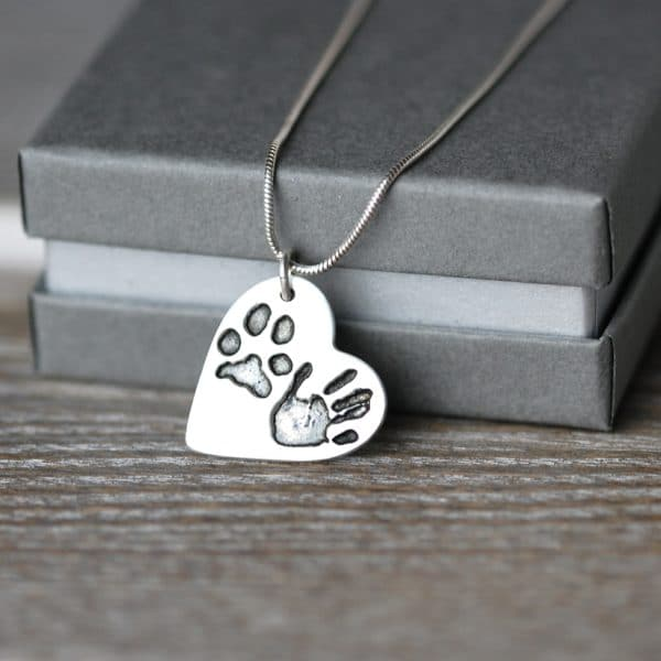 Silver heart necklace with your pet's paw print and child's handprint