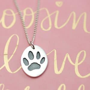 Regular sterling silver oval paw print charm