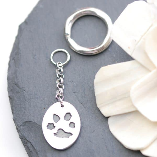 Sterling silver oval keyring showcasing your pet's unique paw print
