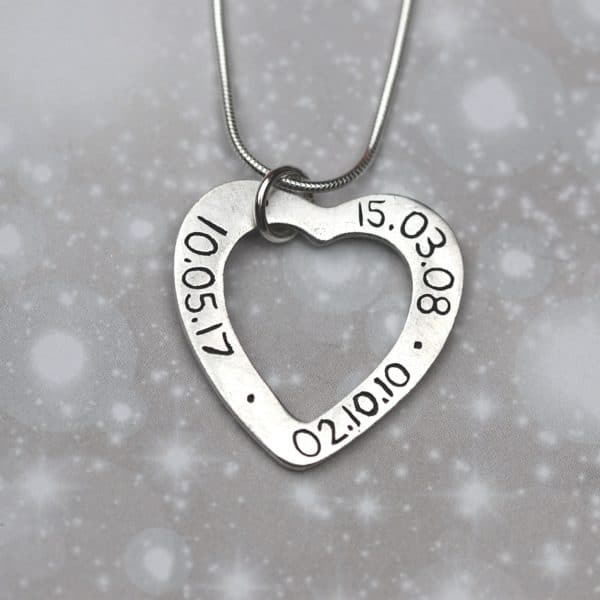 Inscription on the back of silver heart shaped name charm