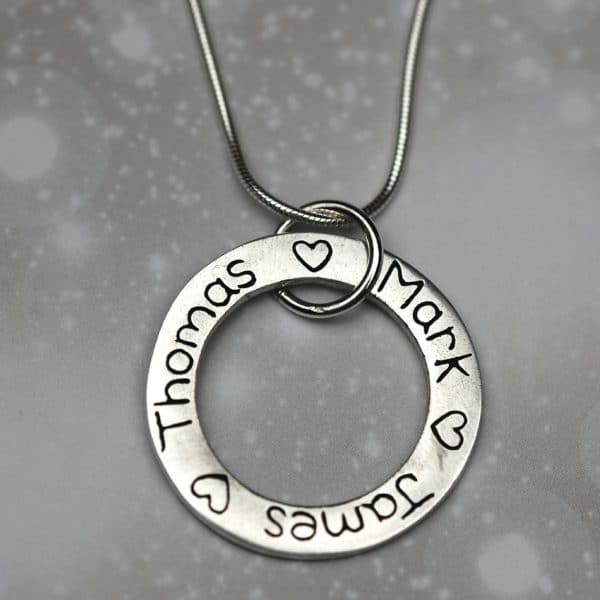 Sterling silver charm personalised with names, dates and messages