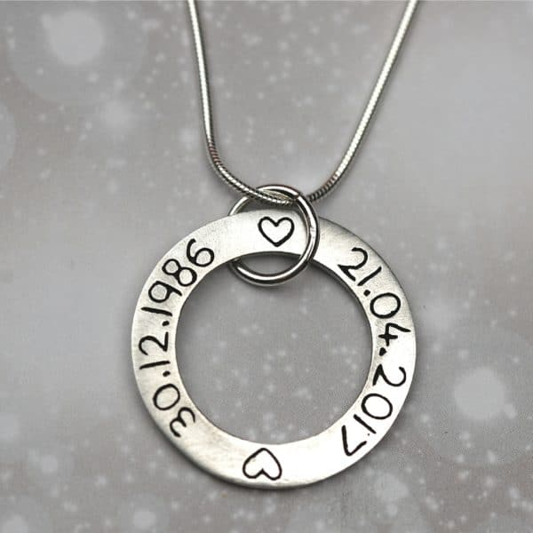 Inscription on the back of silver message charm