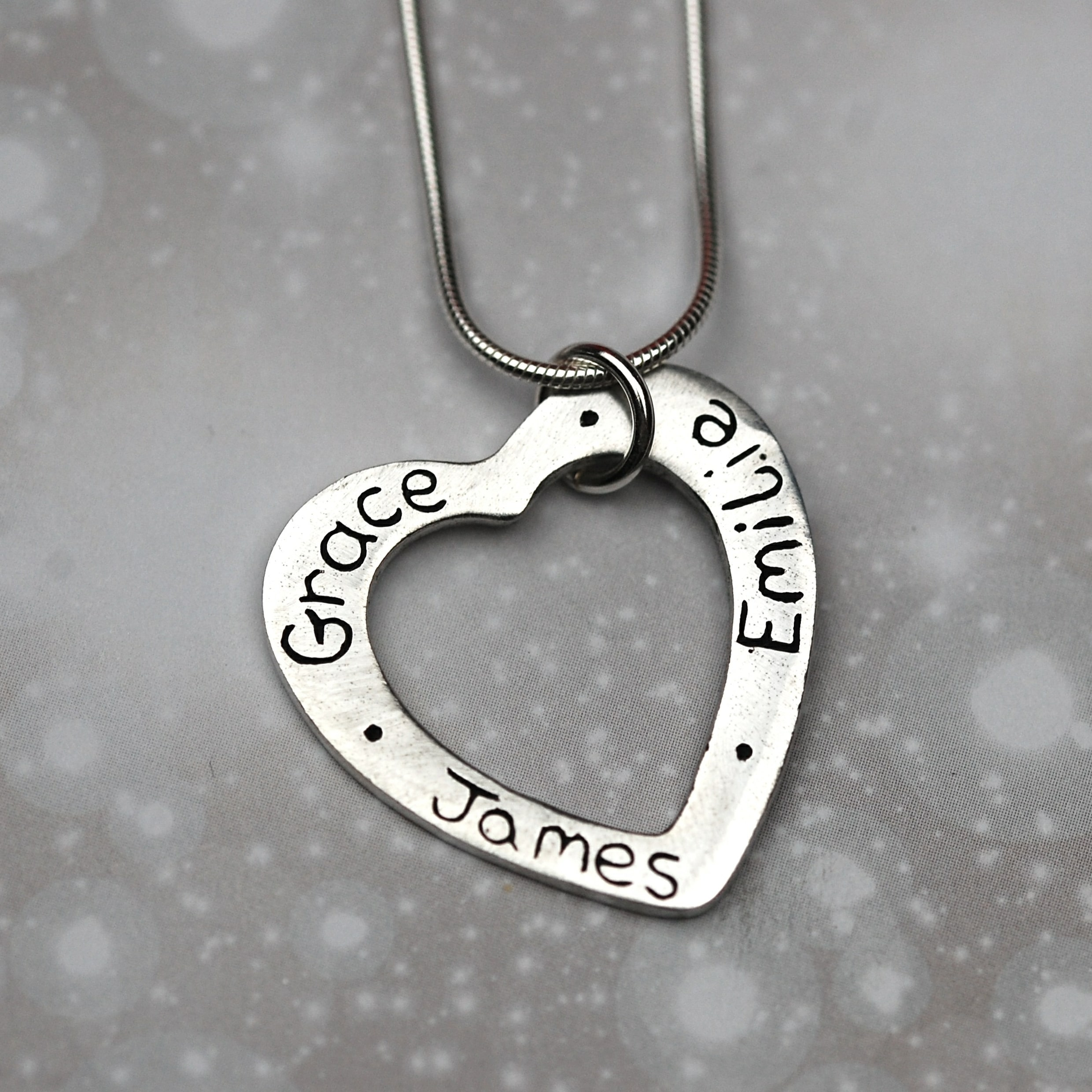 e91c1c18bef9d Say It In Silver Name Charm