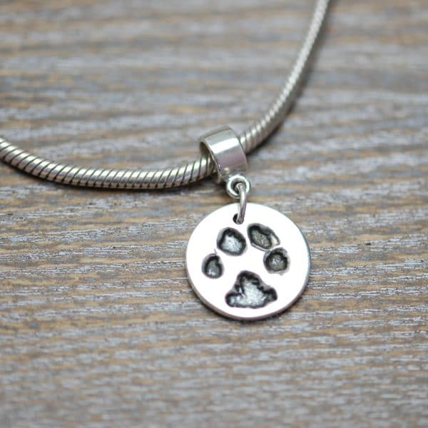 Silver circle paw print charm with charm carrier