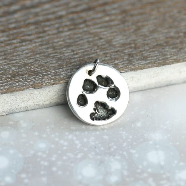 Small sterling silver charm with your pet's unique paw print and name