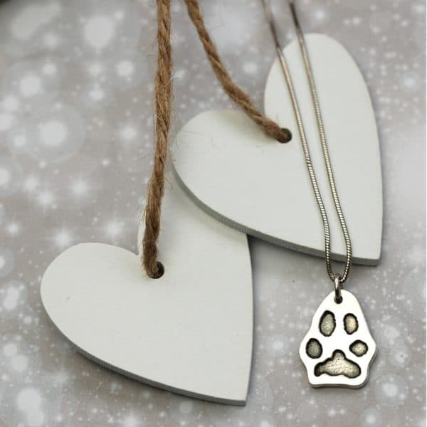 Silver charm cut out in the shape of your pet's unique paw print