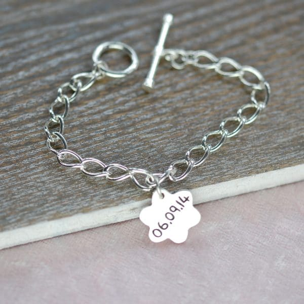 Small sterling silver charm with special date