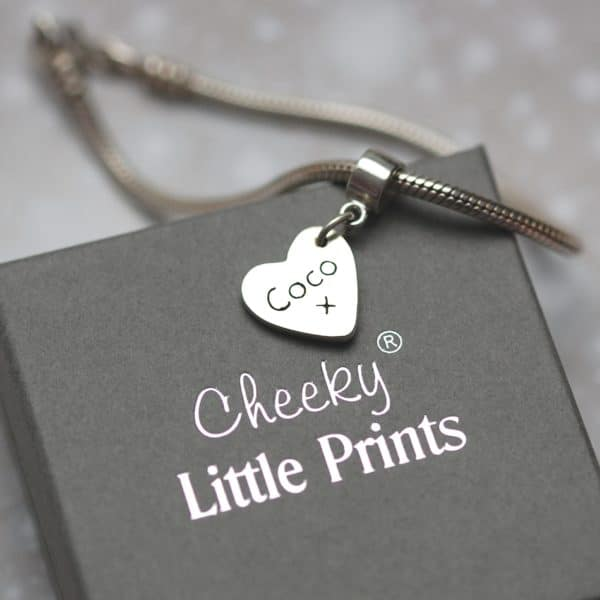 Inscription on the back of raised paw print charm