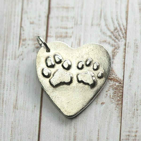 Sterling silver heart with your pet's raised paw prints