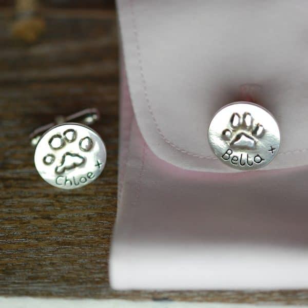 Silver raised paw print cufflinks