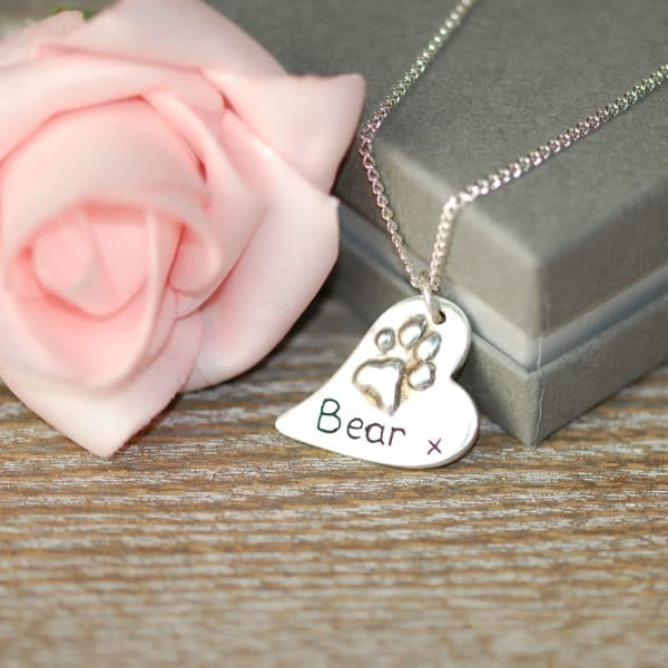 Regular raised paw print charm