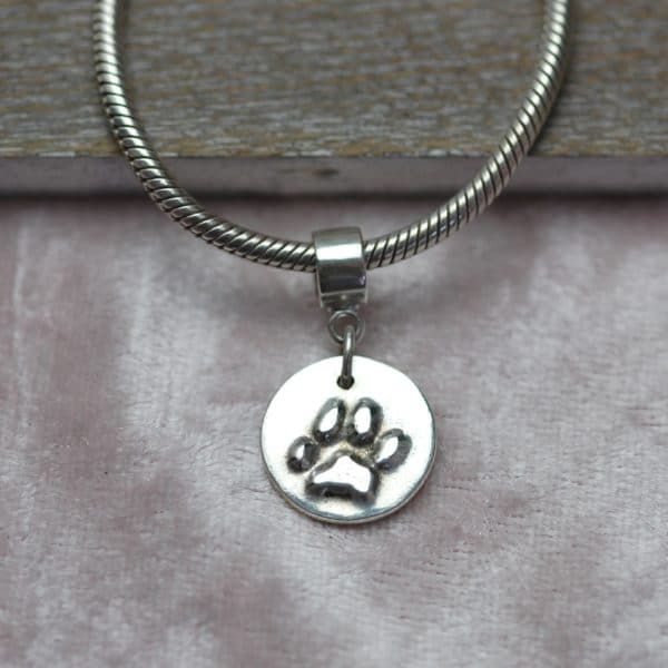 Small silver raised paw print charm and charm carrier