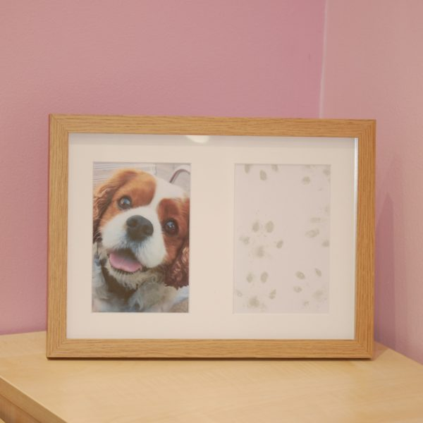 French oak effect frame part of paw print kit with dog paw print and photo keepsake