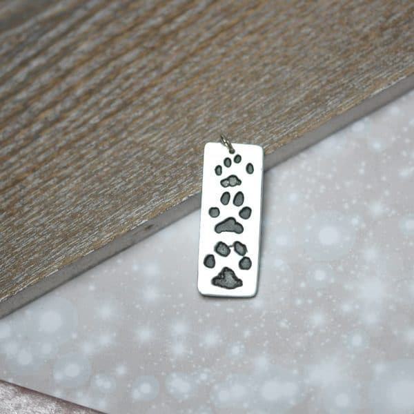 Sterling silver triple paw print charm