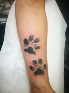 Billy and Molly paw print tattoo