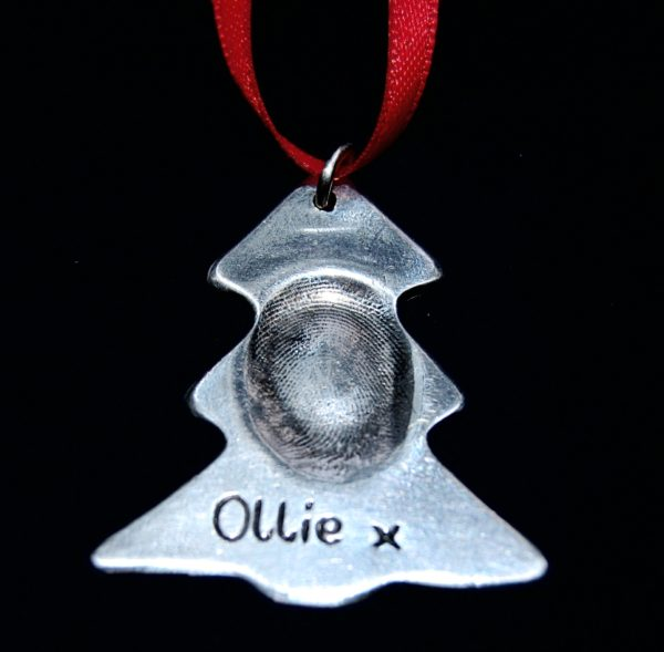 Stunning silver Christmas tree fingerprint charm. Presented on red ribbon, ready to hang on your tree.