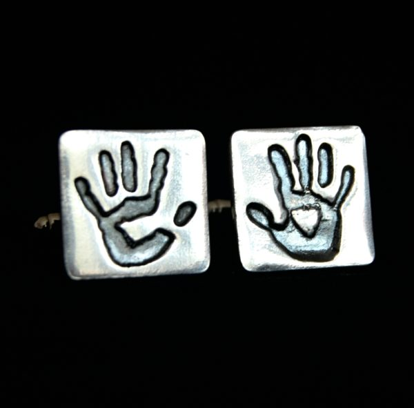 Square silver cufflinks with adult handprints. Name hand inscribed on the back.