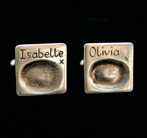 Square shaped silver fingerprint cufflinks with names hand inscribed above the prints.