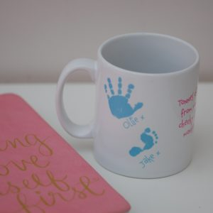Personalised mug with hand and footprint