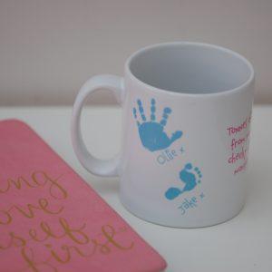 Personalised mug with hand and footprint
