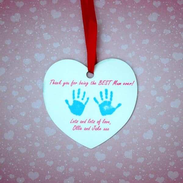 Heart shaped decoration personalised with your child's hand and footprint
