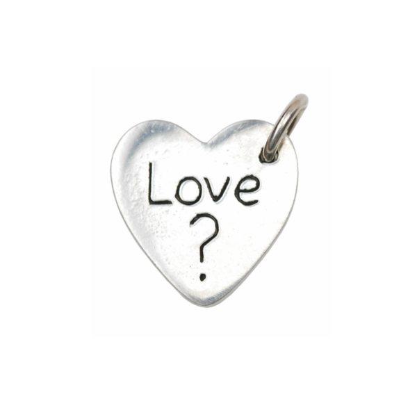 Inscription on the back of a kiss imprint charm