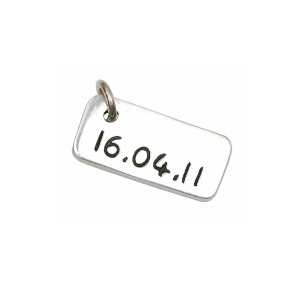 Inscription on the back of a signature charm