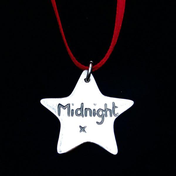 Inscription on the back of a star Christmas charm.