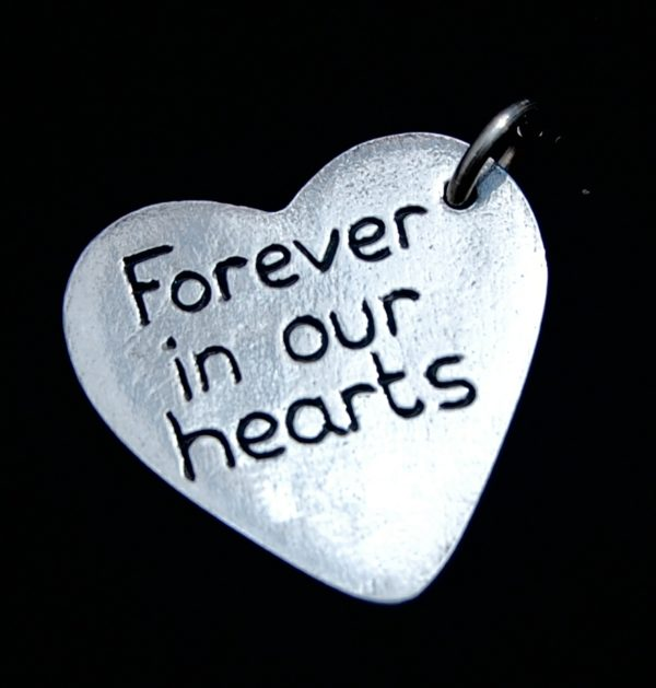 Have your own special message hand inscribed on the back of your charm.