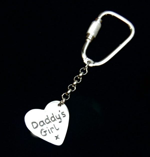 Inscription on the back of silver heart keyring.
