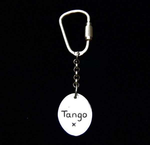 Name hand inscribed on the back of an oval horse shoe keyring.