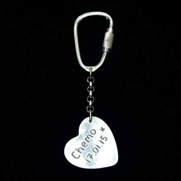 Name and special date hand inscribed on the back of a large heart keyring.