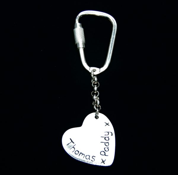 Inscription on the back of a heart shaped silver keyring.