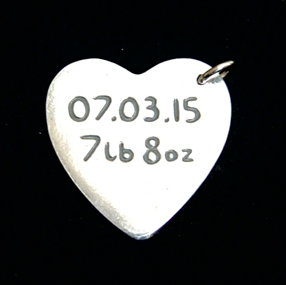 Your little one's date of birth and birth weight can be hand inscribed on the back of your fingerprint charm.