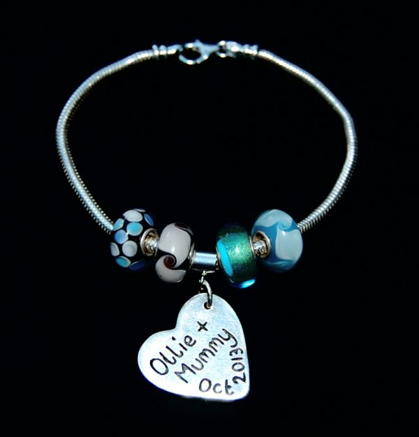 Personalised message on the back of a doodles and signature charm. Bracelet can be purchased separately.
