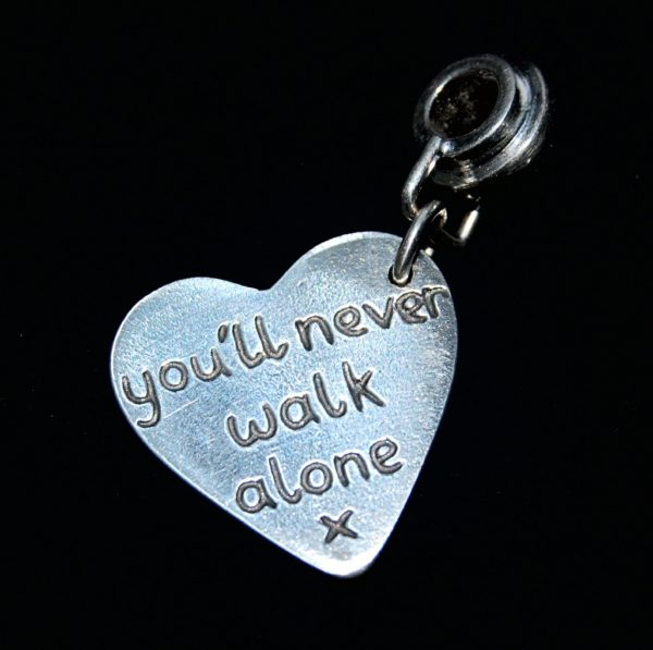 Capture your special message on the back of your charm.